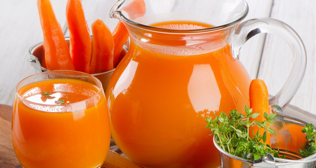 Carrot juice with fresh herbs. Selective focus